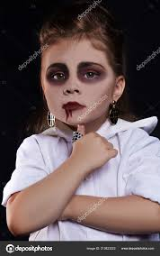 dracula child little with halloween make up vimpire kid with blood on her face halloween holiday children photo by photoagents