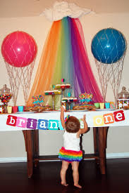 colorful rainbow curtain side red and blue ball closed cute cake and candy on white tablecloth
