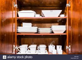 open cabinet door. Exellent Open Open Wooden Kitchen Cabinet Door Cupboard With Many White Dishes Plates  Cups On Shelves Closeup And Cabinet Door