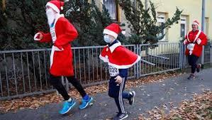 small group of germans dressed in santa