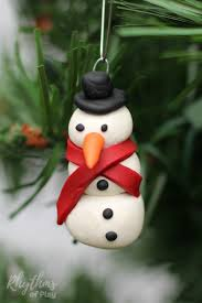 A homemade DIY polymer clay snowman ornament to decorate your Christmas tree!  An easy handmade