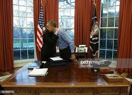 desk oval office. s president barack obama hugs staff secretary joani walsh after signing 12 bills at his desk the oval office