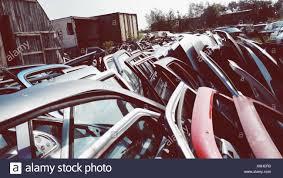 abandoned car doors at junkyard stock image