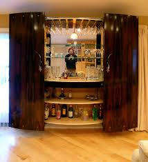 contemporary bar furniture. Awesome Contemporary Bar Cabinet Design Along With Varnished Wood Sliding Door And Glass Shelves Equipment Furniture
