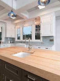 sink lighting. elegant kitchen photo in portland with an undermount sink wood countertops recessedpanel lighting b