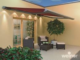 weinor opal design lux on a patio markilux awning eliminating low lying sun