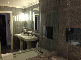 covent garden hotel bathroom with a large bathtub and lcd embedded to the wall