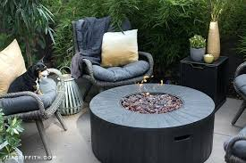 outdoor fire pit from with wicker seats saffron pillows plants hayneedle propane table