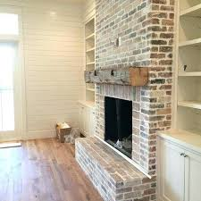 built in bookshelves around brick fireplace cabinets