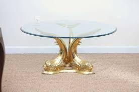 solid cast brass coffee table that makes a glamorous statement beveled glass top
