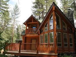 beautiful solid log cabin front view