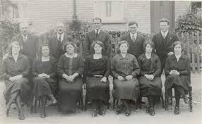 Members of the Bull family of Downfields, Soham. Back: Bill, Jim, Arl, Son,  Jack. Front: Ada, Bertha, Maud, Rose, Amy, Flo, Emily. | Domestic,  Families, Mixed | Soham