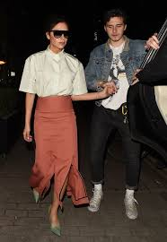 News about victoria beckham on elle. Brooklyn Beckham Is The Doting Son As He Holds Mum Victoria Beckham S Hand Leaving London Wine Bar Mirror Online
