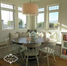 farmhouse kitchen with round breakfast nook plus white curved back chairs style next to corner wooden bench with window seat