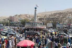Et monday amid a dire chaos at afghanistan's kabul airport as taliban take over country: 0opsds 7hc2mkm