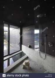 Japanese Shower Design Bathroom In A Japanese Home With Tub And Shower Stock Photo