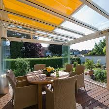 garden glass room with over glass awning shading