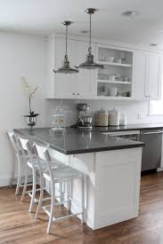 White Kitchen White Floor This Is It White Cabinets Subway Tile Quartz Countertops