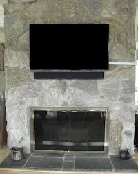 tv installation over stone fireplace
