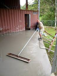 puddle mixing concrete and pouring a big floor