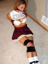 Cheerleader in uniforms bondage