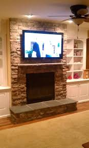 hang tv over fireplace where to put cable box wall mount stone interior design ideas mounting
