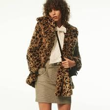 h m faux fur coat blouse with tie short skirt and suede shoulder bag
