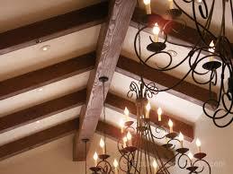 vaulted ceiling lighting installed through heavy sandblasted beams