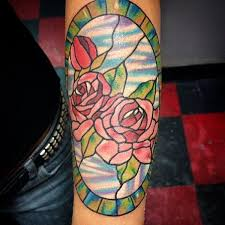a great picture of two roses together in a stained glass design