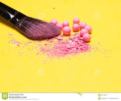 makeup brush with crushed and whole shimmer blush