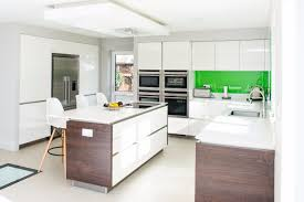 german kitchen brands in uk. white quartz worktops reflect even more light into this fabulous, bright kitchen and dining space green glass splashbacks echo the lovely garden views. german brands in uk