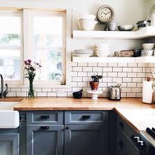 Open shelving, butcher block countertops and grey cabinets, subway tile  backsplash