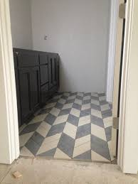 herringbone tile floor. Charming Black Painted Vanity Cabinet As Storage Over Grey White Herringbone Tile Floor