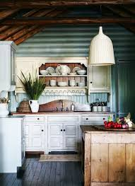 painting log cabin interior walls. cozy log cabin kitchen with blue painted interior wood walls, white shaker cabinets and dark painting walls
