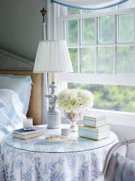 ... Home Patricia Fisher Design - Master bedroom with tan walls paint  color, gray washed bed, Mecox Garden Bone Boxes and round skirted table  nightstand.