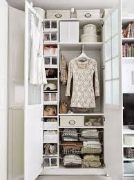 small walk-in closet ideas: walk-in closet with doors and shelves