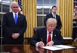 president in oval office. President Trump Signed His First Executive Orders In The Oval Office On Friday Night Within Minutes C
