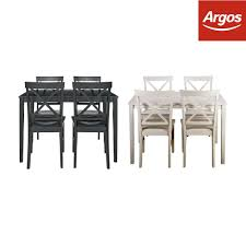 home jessie dining table and cross back chairs white black from argos on