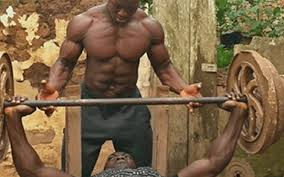this beast african bodybuilder s backyard gym makes prison workouts look like