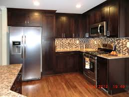 kitchen white wall themes and dark brown varnished wooden oak cabinet on laminate flooring with