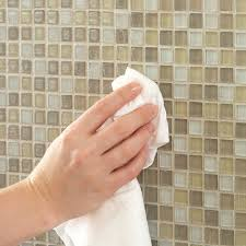 wipe tiles clean with a soft cloth to complete glass mosaic tile backsplash