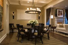 dining room round farmhouse dining table dining room traditional with area rug baseboards centerpiece