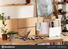 interior artist studio painting supplies laptop potted plants stock photo