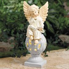 sitting angel statue with warm solar light outdoor lighting