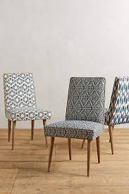 like fabric dining chairs hmm i like the upholstery and contrasting piping of the left chair tiled zolna chair anthropologie