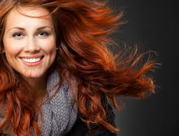 close up of beautiful woman face with red curly hair