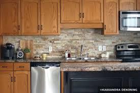 wood cabinets with stone tile backsplash kitchen