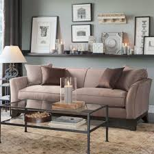 wall to wall floating shelf above sofa but rustic might