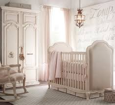 baby bedroom wall letters painting curtains wardrobe rocking arm chair tapestries chandelier tribal influence international flair