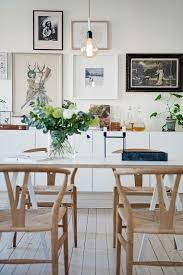 simple warm scandinavian dining room design with perfect replica wishbone chairs in natural color